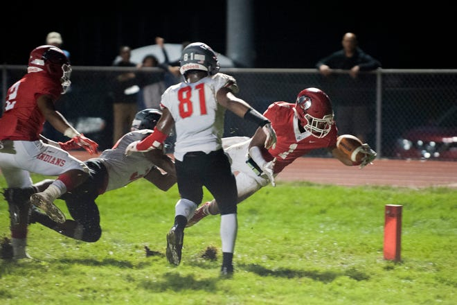 Lenape's Xavier Coleman (1) dives into the end zone for a touchdown against Vineland Friday, Sept. 14, 2018 at Lenape High School in Medford, N.J.
