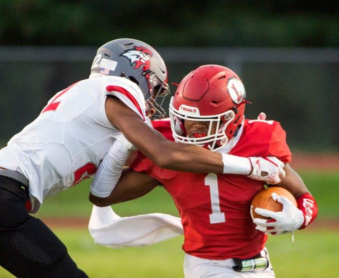 Lenape's Xavier Coleman (1) carries the ball against Vineland Friday, Sept. 14, 2018 at Lenape High School in Medford, N.J.