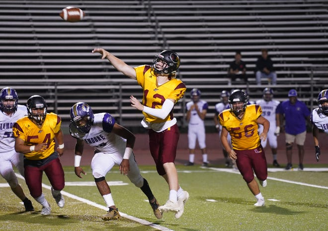 Tulare Union quarterback Nathan Lamb makes a throw against Lemoore during their football game in 2018 at Bob Mathias Stadium in Tulare.