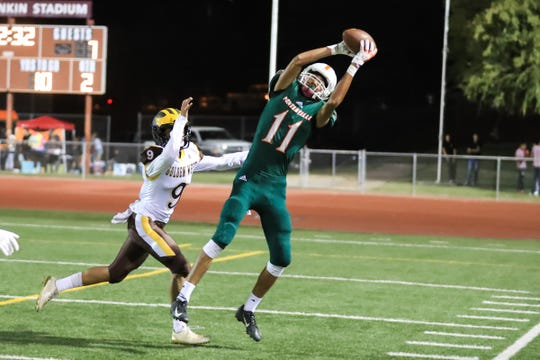 Porterville's Hunter Alcantar (11) catches a pass against Golden West's Alize Alvarez (9) during a non-league high school football game at Jacob Rankin Stadium on Sept 14th, 2018.