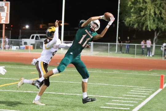 Porterville's Hunter Alcantar hauls in a pass hosts against Golden West at Jacob Rankin Stadium on Sept 14th, 2018.