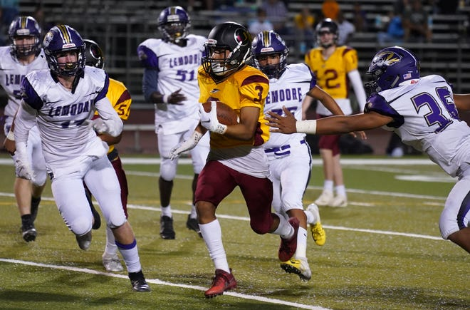 Tulare Union's Vicente Mosqueda gets past the Lemoore defense during their football game on Sept. 14 at Bob Mathias Stadium in Tulare.