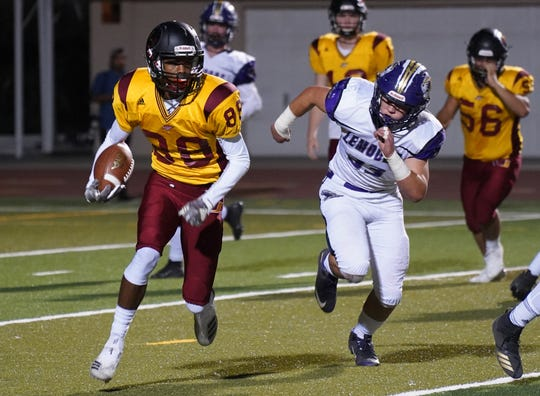 Tulare Union's Willie James runs against the Lemoore defense during their football game on Friday night at Bob Mathias Stadium in Tulare.