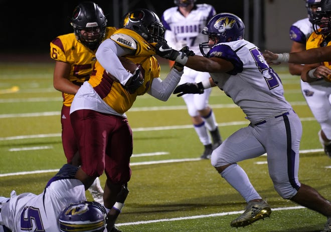Tulare Union's Donovan Smith runs against the Lemoore defense during their football game on Friday night at Bob Mathias Stadium in Tulare.