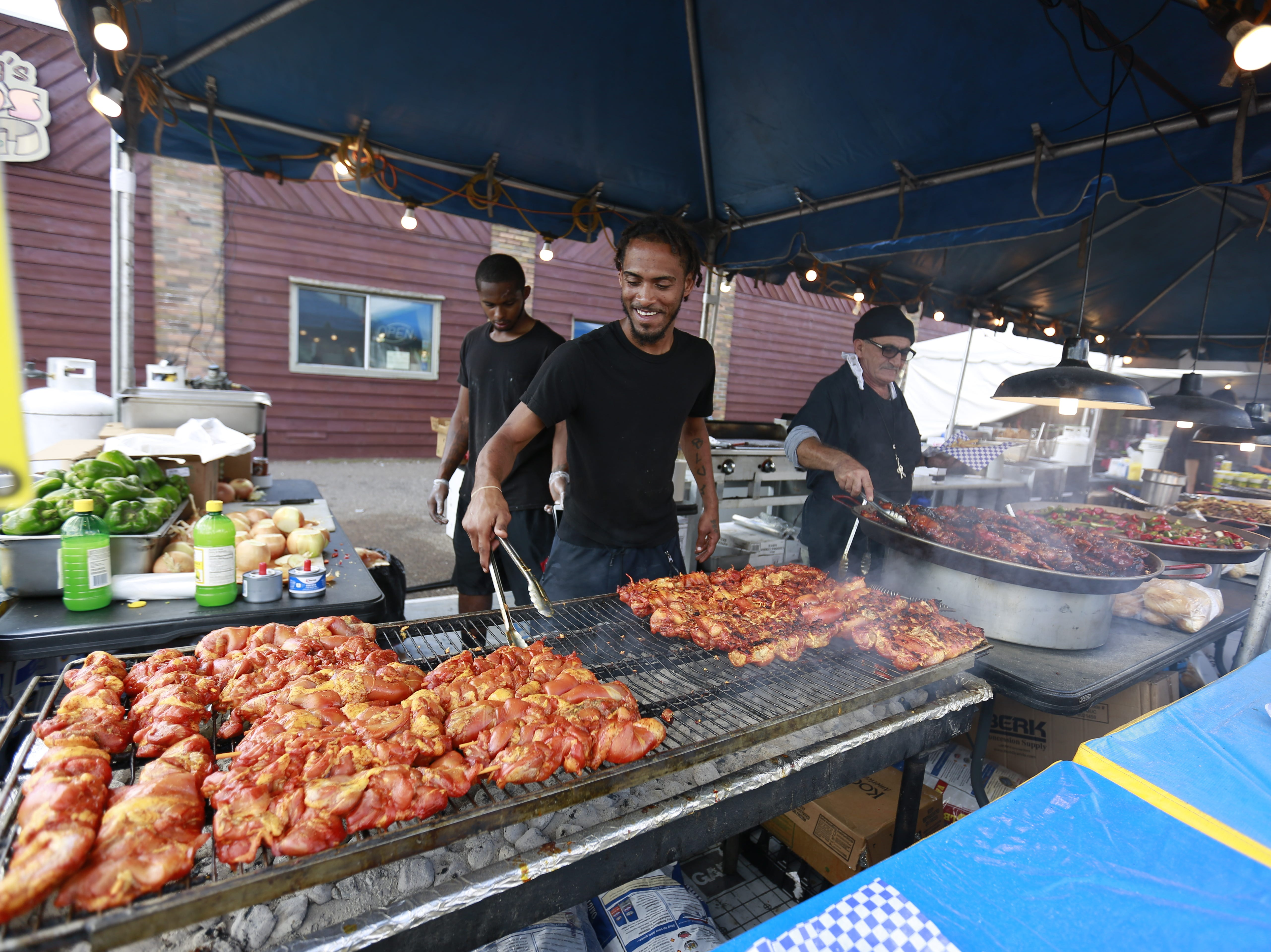 James Richard, of Miami, Florida, grills chickens during the 37th Annual Tomahawk Fall Ride Friday, Sept. 14, 2018, at downtown Tomahawk, Wis. T'xer Zhon Kha/USA TODAY NETWORK-Wisconsin