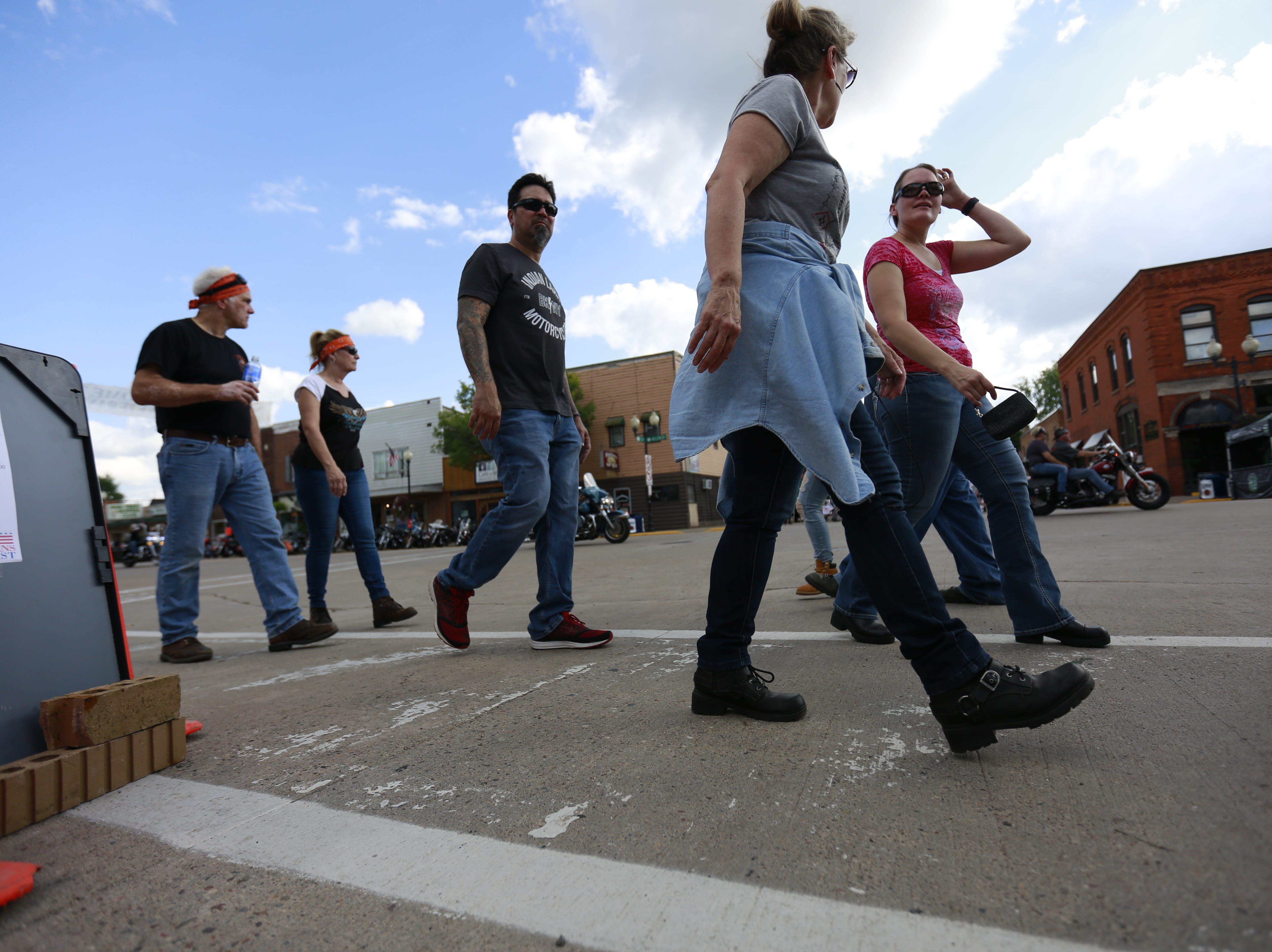 People crossing the road during the 37th Annual Tomahawk Fall Ride Friday, Sept. 14, 2018, at downtown Tomahawk, Wis. T'xer Zhon Kha/USA TODAY NETWORK-Wisconsin