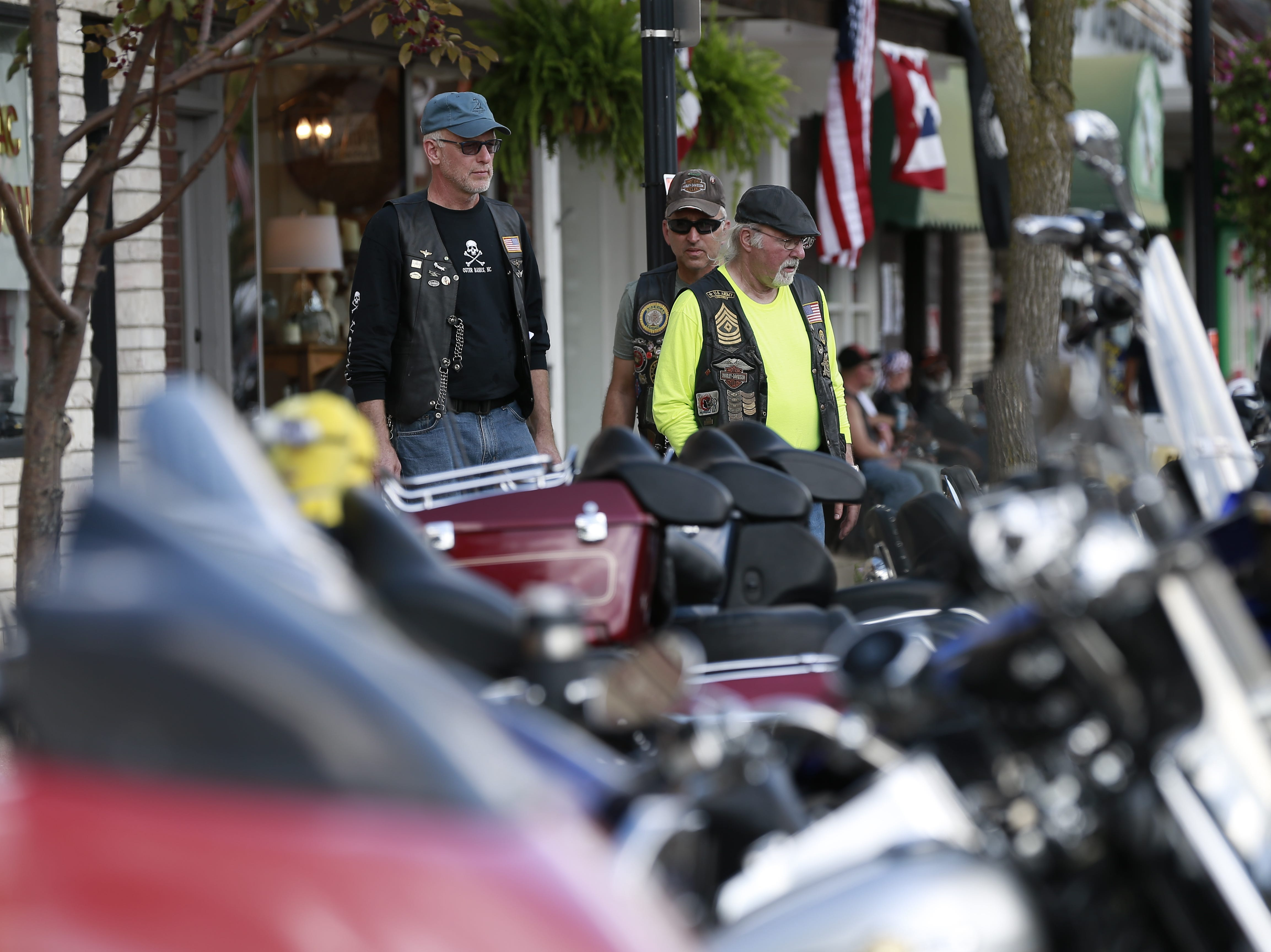Bikers look on motorcycles during the 37th Annual Tomahawk Fall Ride Friday, Sept. 14, 2018, at downtown Tomahawk, Wis. T'xer Zhon Kha/USA TODAY NETWORK-Wisconsin