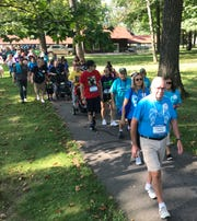 More than 300 people from all walks of life and backgrounds participated in the Out of the Darkness suicide prevention walk in Wausau's Marathon Park.