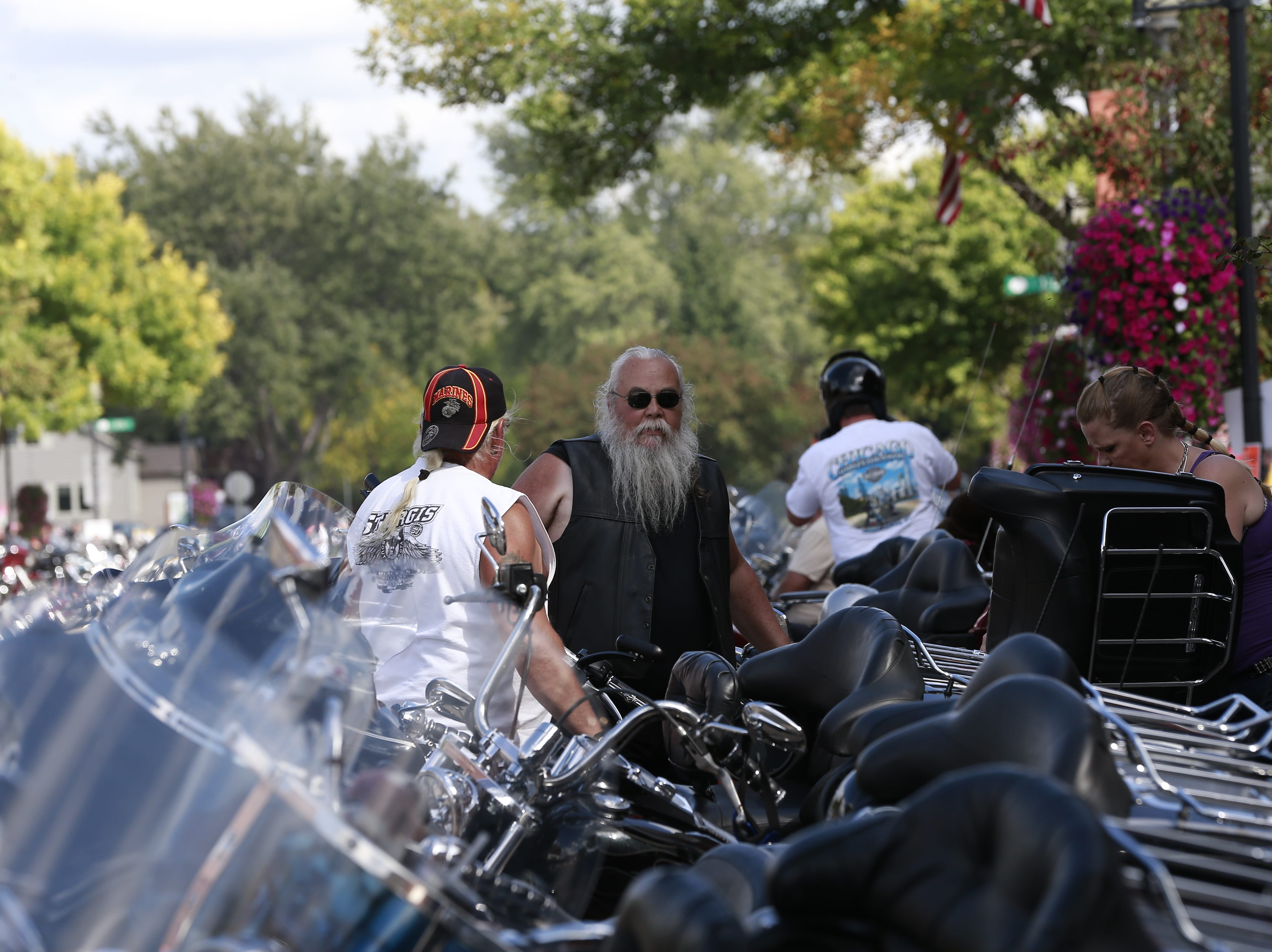 Bikers check on motorcycles during the 37th Annual Tomahawk Fall Ride Friday, Sept. 14, 2018, at downtown Tomahawk, Wis. T'xer Zhon Kha/USA TODAY NETWORK-Wisconsin