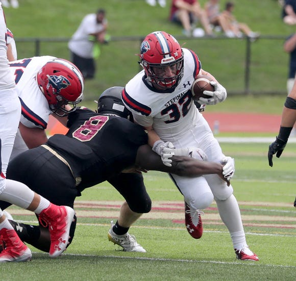 Stepinac's Kevin McKenna rushes against Iona Prep during a varsity football game at Iona Prep in New Rochelle Sept. 15, 2018.