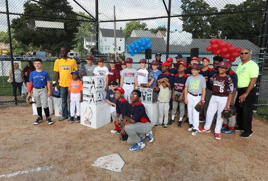 The Mount Vernon and Scarsdale baseball teams gather around boxes of new baseball equipment before a game at Brush Park in Mount Vernon, Sept. 15, 2018. Evan Schiff, 12, from Scarsdale, as part of his bar mitzvah project, raised $9,000 from friends and family and with the help from Pitch in for baseball and softball was able to deliver $20,000 worth of gear to Mount Vernon.