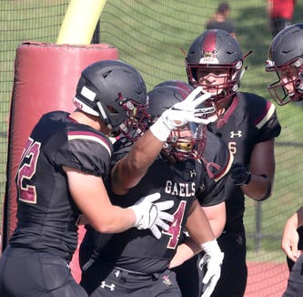 Iona Prep's Franklin McFadden III, center, celebrates with teammates after scoring a two-point conversion in overtime against Stepinac during a varsity football game at Iona Prep in New Rochelle Sept. 15, 2018. The two point conversion proved to be the difference as Iona Prep defeated Stepinac 36-34.