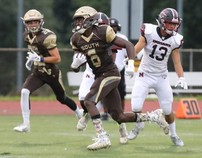 Clarkstown South's RJ Lamarre carries the ball during a game with Nyack at Clarkstown South Sept. 14, 2018. Clarkstown South won 45-0.