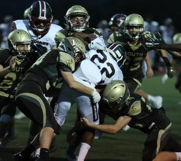 The Clarkstown South defense stops Nyack's Donte Downing during their game at Clarkstown South Sept. 14, 2018. Clarkstown South won 45-0.