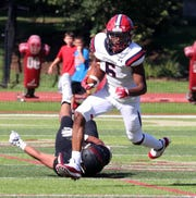 Stepinac's Shawn Harris rushes against Iona Prep during a varsity football game at Iona Prep in New Rochelle Sept. 15, 2018.
