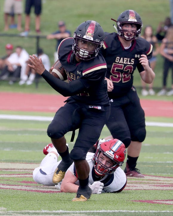 Iona Prep's Jayden Lambert breaks free of Stepinac's Kevin McKenna for a long run in the fourth quarter of a varsity football game at Iona Prep in New Rochelle Sept. 15, 2018. Iona Prep defeated Stepinac in overtime 36-34.
