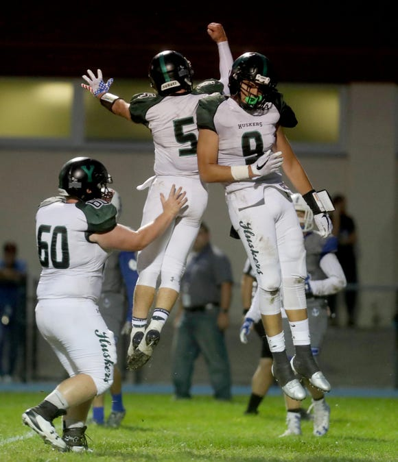 Yorktown quarterback Tommy Weaver and receiver Naim Sinanaj celebrated after Weaver found Sinanaj for a touchdown pass against Hendrick Hudson during a varsity football game at Hendrick Hudson High School Sept. 14, 2018. Yorktown defeated Hendrick Hudson 28-13.