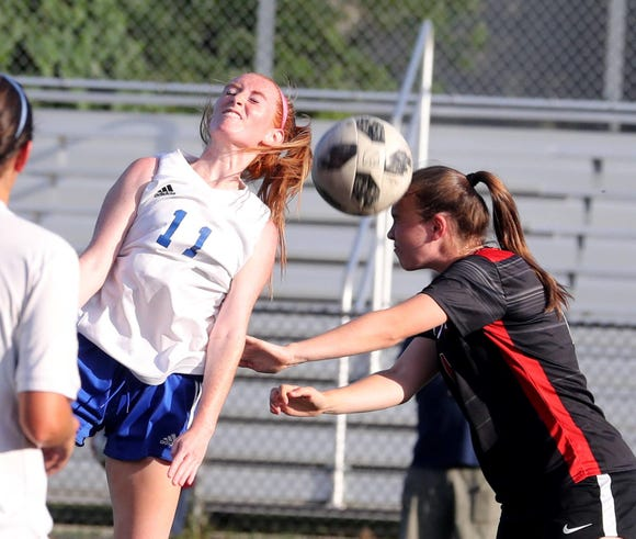 Tara Guilfoyle of Pearl River and Katie Sack of Rye battle during a varsity soccer game at Rye High School Sept. 15, 2018.