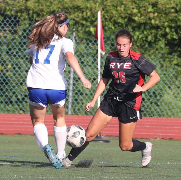 Maeve Woods of Pearl River and Sara DeGraw of Rye battle during a varsity soccer game at Rye High School Sept. 15, 2018.