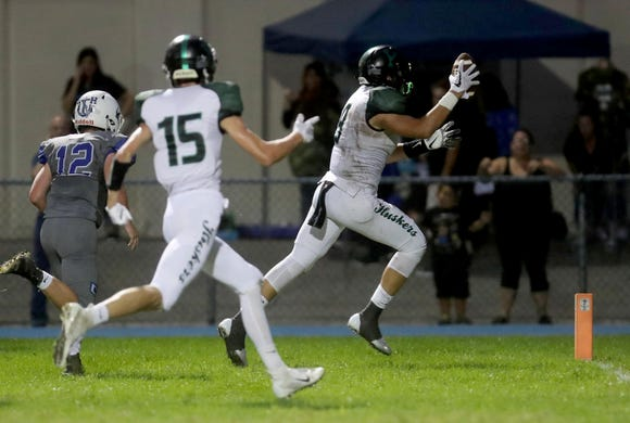 Yorktown's Naim Sinanaj scores on a pass from quarterback Tommy Weaver against Hendrick Hudson during a varsity football game at Hendrick Hudson High School Sept. 14, 2018. Yorktown defeated Hendrick Hudson 28-13.