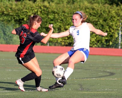 Sara DeGraw of Rye and Alyssa Portington of Pearl River battle during a varsity soccer game at Rye High School Sept. 15, 2018.