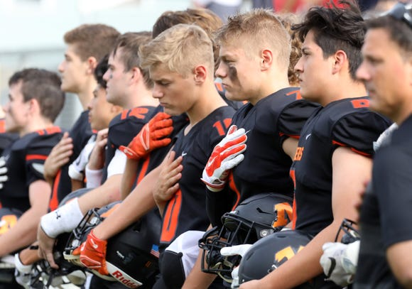 Mamaroneck players during the national anthem before their football game against New Rochelle at Mamaroneck High School Sept. 14, 2018. New Rochelle won, 48-7.
