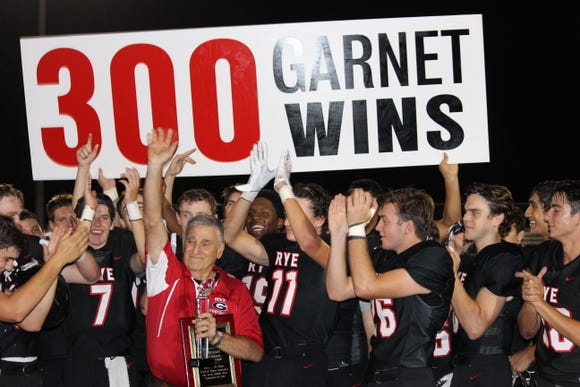 Rye coach Dino Garr is saluted after earning his 300th career win. Rye beat Sleepy Hollow 47-7 at Rye High School on Sept. 14, 2018.