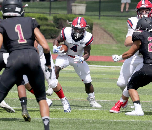 Stepinac's Malik Grant rushes during a varsity football game against Iona Prep at Iona Prep in New Rochelle Sept. 15, 2018. Iona Prep defeated Stepinac in overtime 36-34.