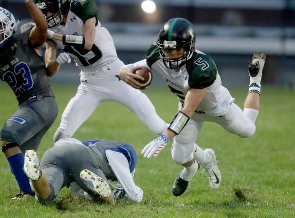 Yorktown quarterback Tommy Weaver rushes against Hendrick Hudson during a varsity football game at Hendrick Hudson High School Sept. 14, 2018. Yorktown defeated Hendrick Hudson 28-13.