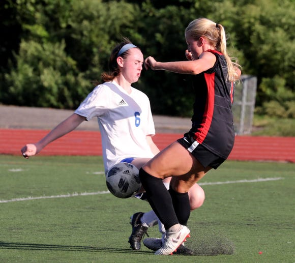 Sarah Donovan of Pearl River Mia McGinty of Rye battle during a varsity soccer game at Rye High School Sept. 15, 2018.