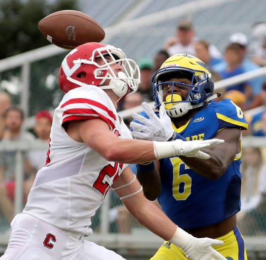 Delaware's Jamie Jarmon is stymied on a likely touchdown reception as Cornell's David Jones gets in the way of a reception in the end zone in the second quarter at Delaware Stadium Saturday.