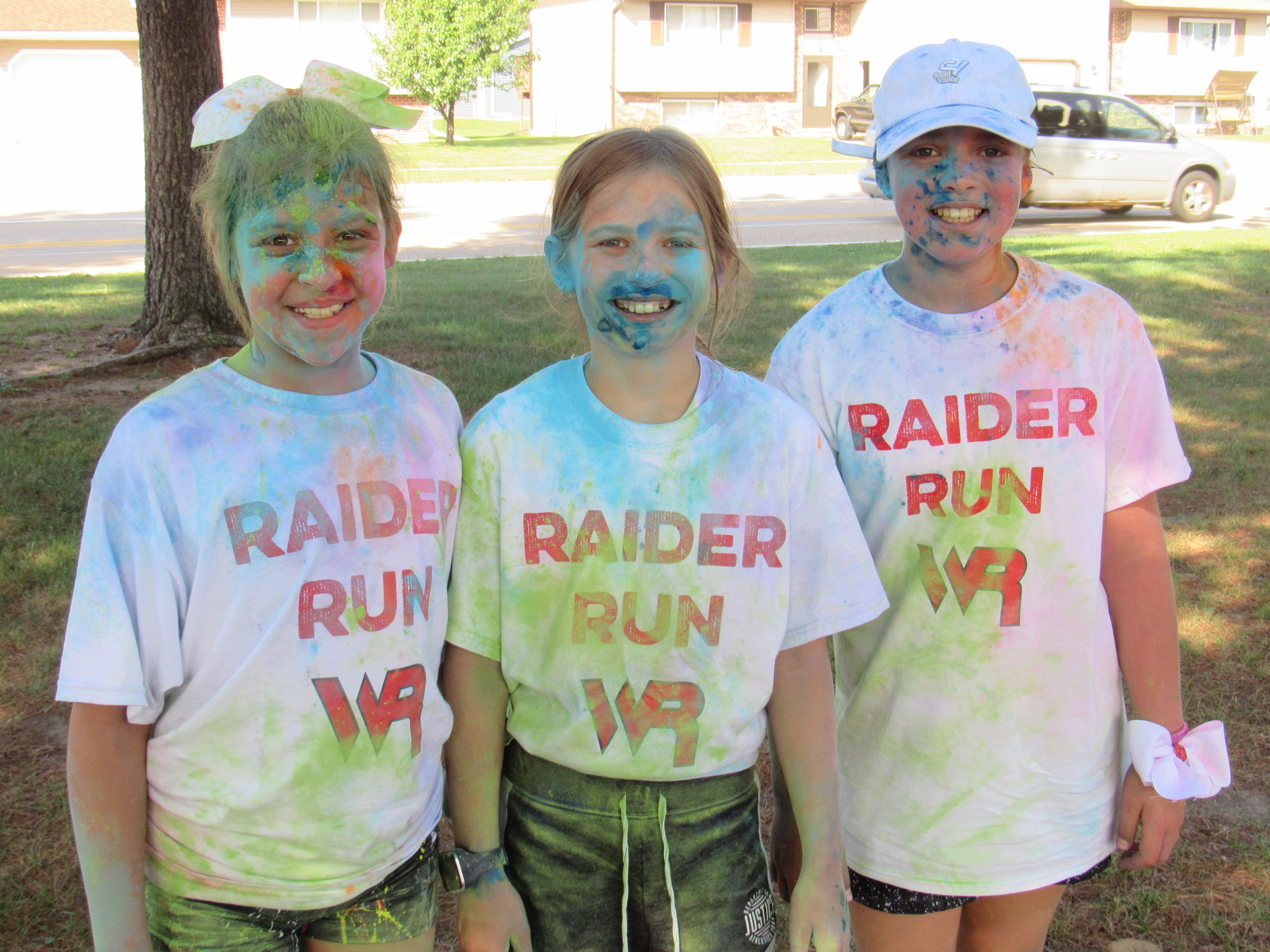 Runners pose for a photo at the end of the Lincoln High School Cheer & Stunt Color Run Saturday, Sept. 15, 2018, in Wisconsin Rapids.