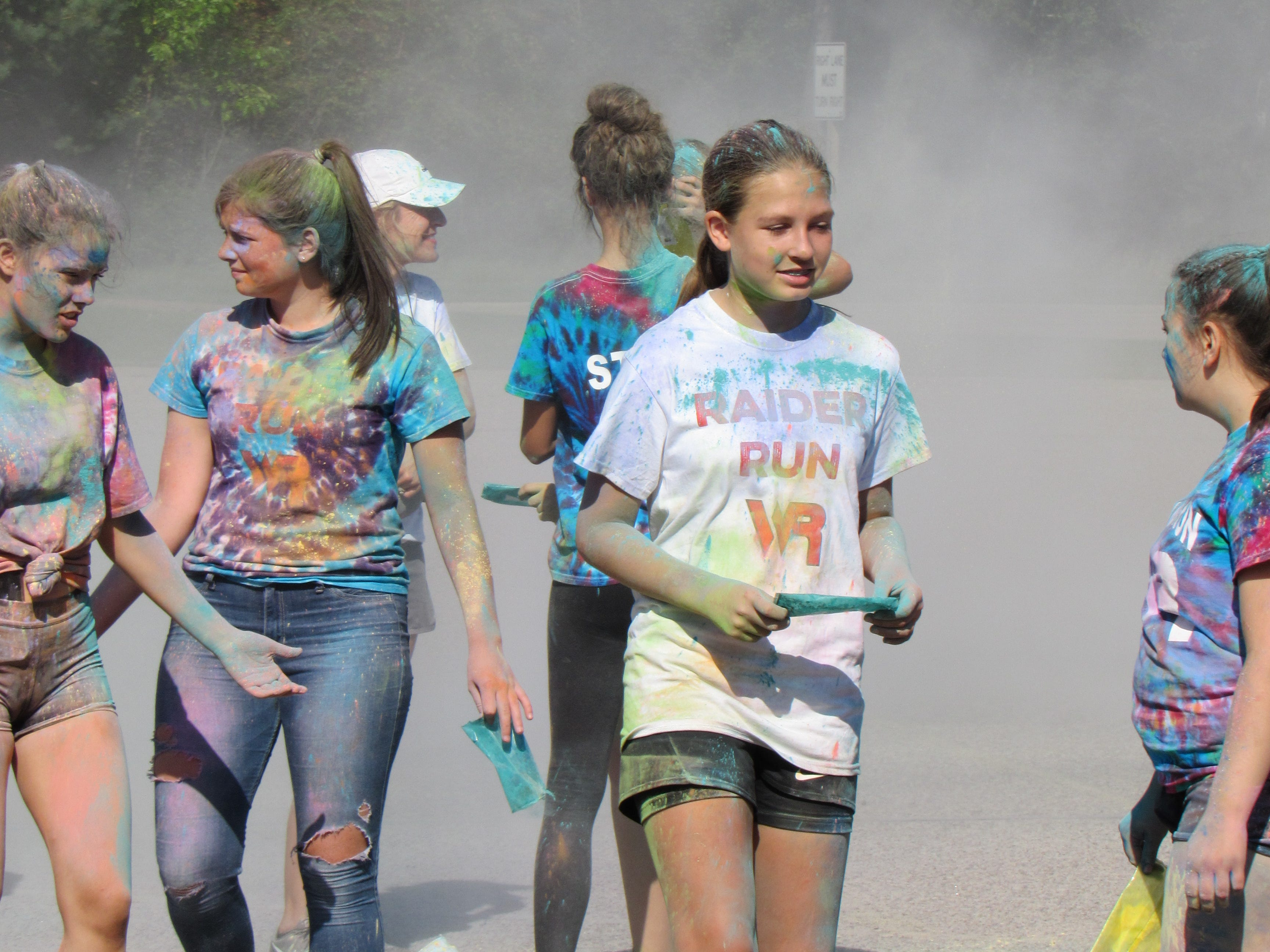 Participants gather at the end of the Lincoln High School Cheer & Stunt Color Run Saturday, Sept. 15, 2018, in Wisconsin Rapids.