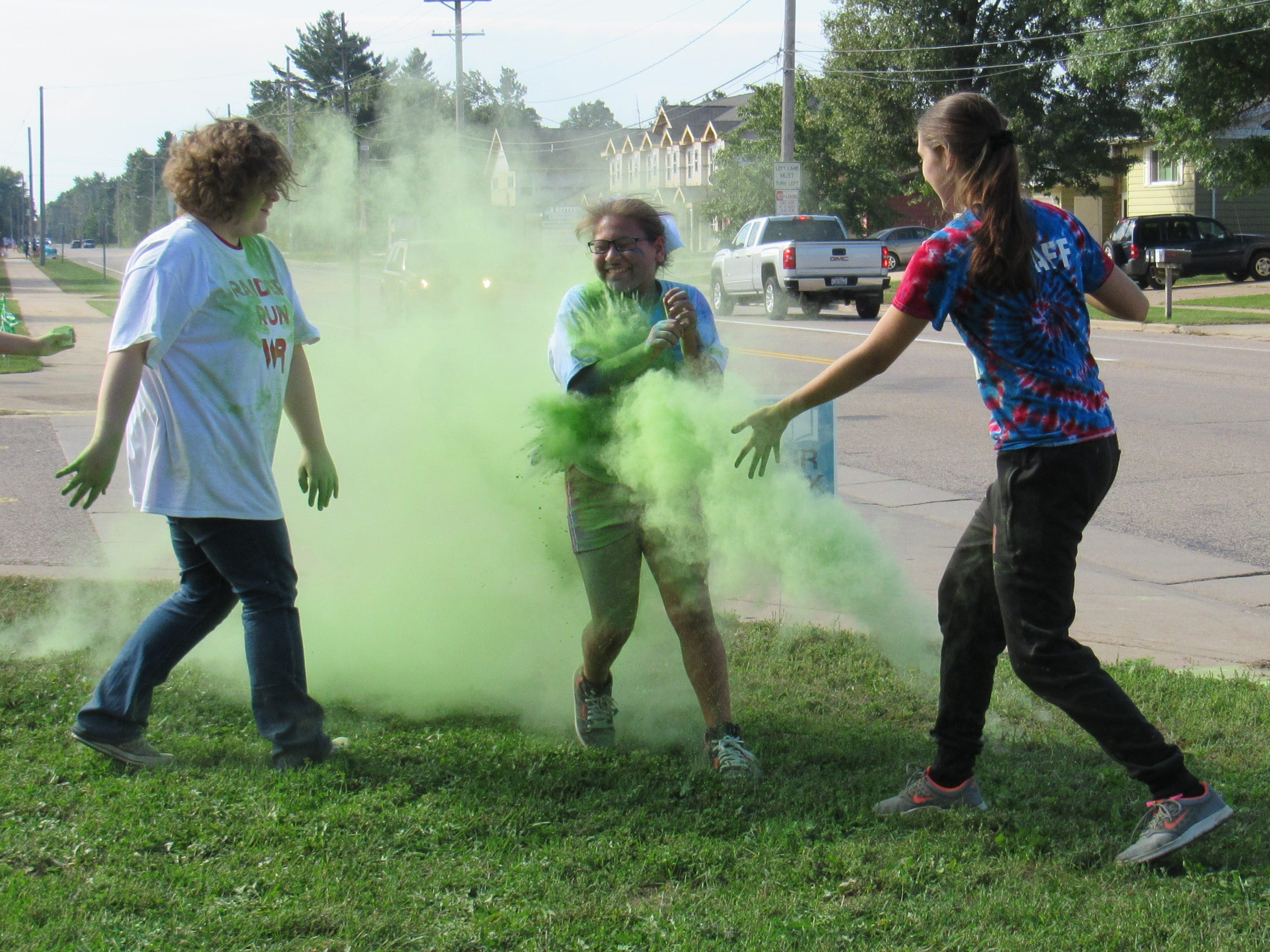 Participants run through a red color station during the Lincoln High School Cheer & Stunt Color Run Saturday, Sept. 15, 2018, in Wisconsin Rapids.