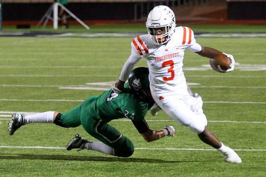 Iowa Parks Kaden Ashlock attempts the tackle on Burkburnett's Jacob Williams Friday evening in Iowa Park as the Hawks hosted the Burkburnett Bulldogs in 4A action .