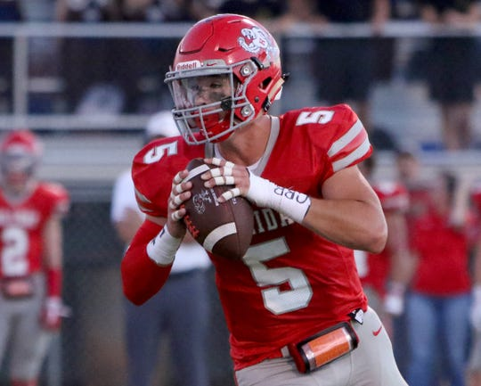 Holliday's Jett Johnson looks for an open reciever against Windthorst Friday, Sept. 14, 2018, in Holliday. The Eagles defeated the Trojans 51-7.
