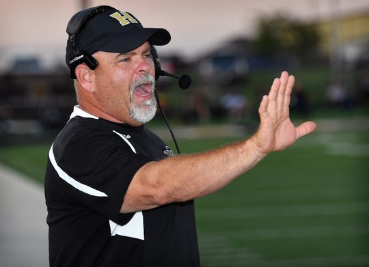 Henrietta Bearcats head coach Byron West calls signals in to his players during Friday night's game against Bowie.