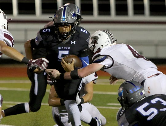 City View's Isaiah Marks is tackled by Seymour's Jayce Hudson Friday, Sept. 14, 2018, in City View. The Panthers defeated the Mustangs 33-13.
