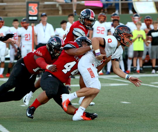 Wichita Falls High School's Jimmy Tran (44) brings down Dumas' Spencer Williams (9) earlier this season. Tran has 20 tackles, including a sack and three for loss as a team captain this season.