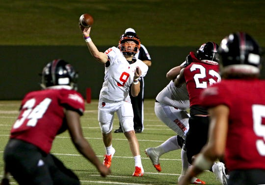 Dumas quarterback Spencer Williams (9) throws a pass that was intercepted by Wichita Falls High's Elijah Bell (34) Friday, Sept. 14, 2018, at Memorial Stadium.