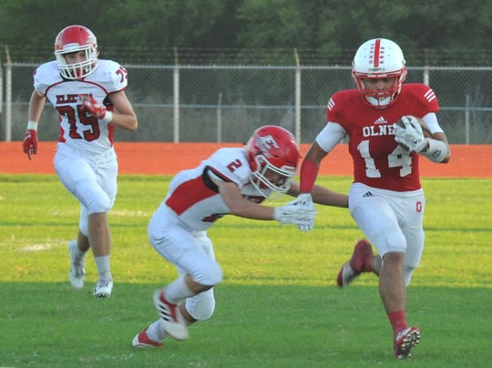 Olney running back Andrew Tellez gains some ards shortly before being brought down by Electra's Shane Hopkins during the first half of the Friday night.