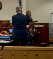 April Kendrick, firearms evidence expert, testifies before the jury about the alleged murder weapon Friday. Kendrick works at the Southwestern Institute for Forensic Sciences.