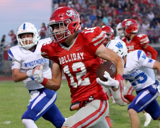 Holliday's Connor Cox runs for a touchdown against Windthorst Friday, Sept. 14, 2018, in Holliday. The Eagles defeated the Trojans 51-7.