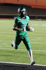 Slayton Ochoa takes the ball in for the easy touchdown Friday evening in Iowa Park as the Hawks hosted the Burkburnett Bulldogs in 4A action .