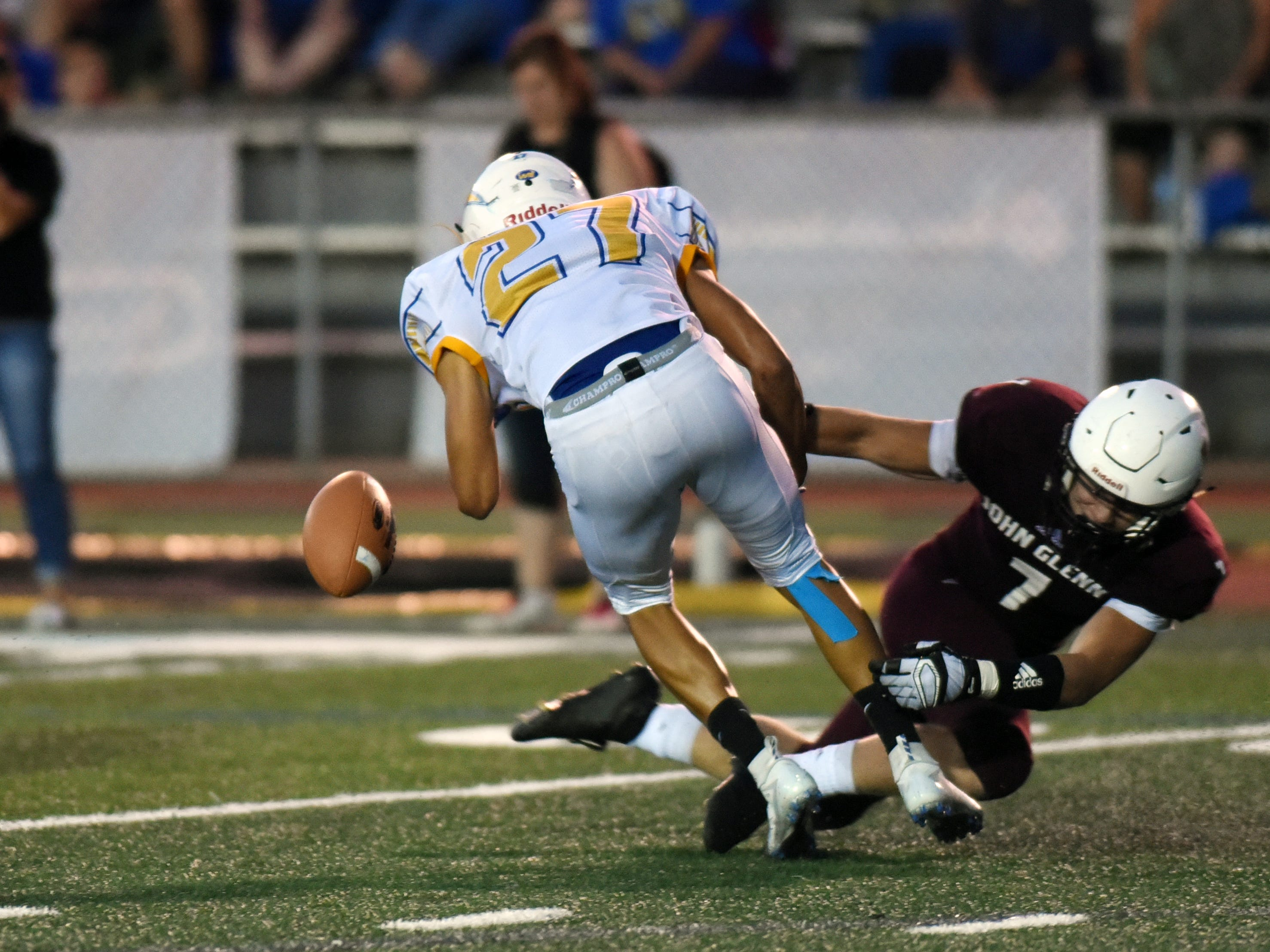 John Glenn's Score Perkins forces a fumble during the second half against Philo.