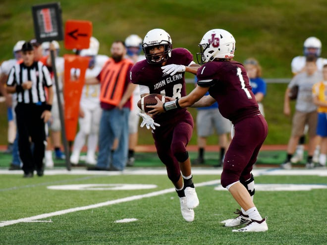 Joseph Clifford takes a handoff from Evan Williams during John Glenn's loss to Philo earlier this season. The Muskies find themselves on the inside of the playoff picture and face New Lex, which is looking for its first playoff berth since 2008.