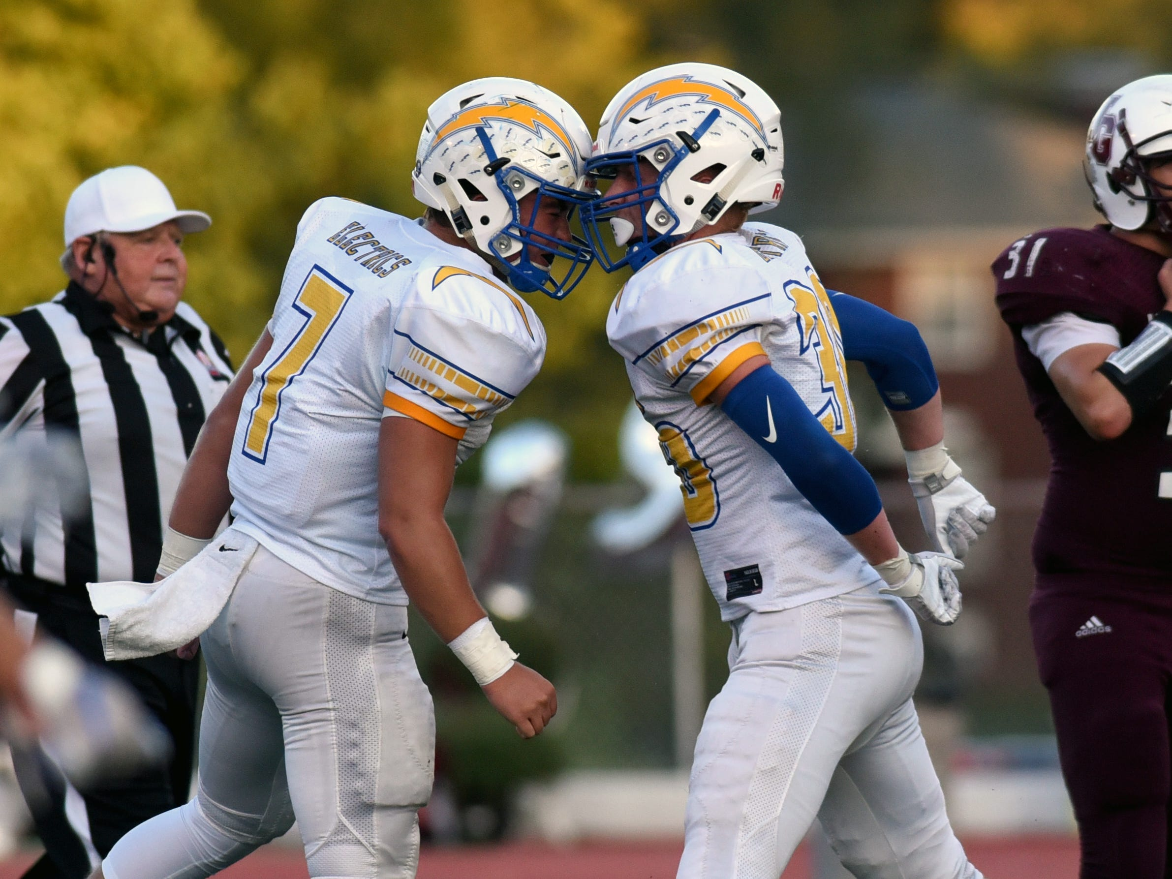 Philo players celebrate a sack in the first half against John Glenn.