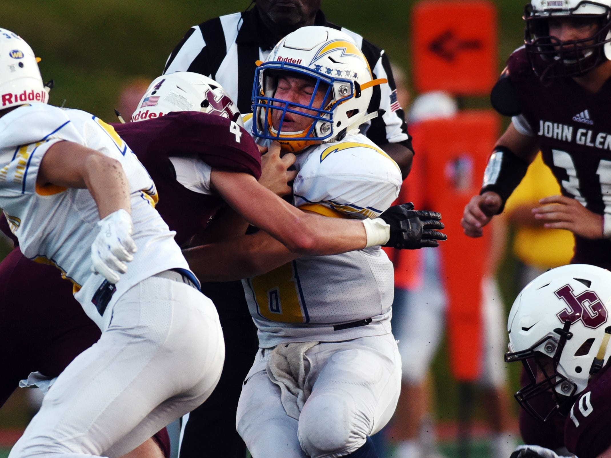 Hunter Adolph is tackled by a John Glenn defender.