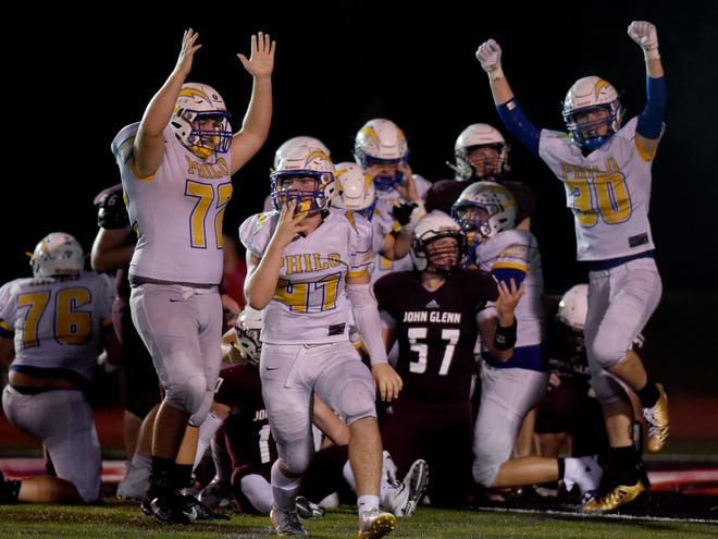 Philo players celebrate Aaron Philip's go-ahead touchdown in the fourth quarter of the Electrics' 15-13 win against John Glenn on Friday night at McConagha Stadium.
