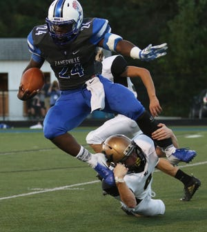 Zanesville's Jalen Haley carries the ball against River View.